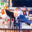 Barman making cocktail drinks - Stock Photo