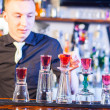 Barman making cocktail drinks — Foto Stock
