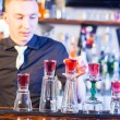 Barman making cocktail drinks — Stock Photo