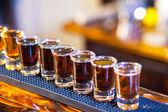 Barman making drink shots — Stock Photo