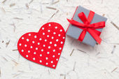 Small gift with woden red heart — Stock Photo