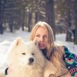 Girl with samoed dog - Stock Photo