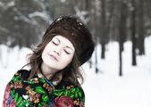 Beautiful girl in a fur hat — Stock Photo