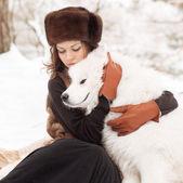 Girl with samoed dog — Stock Photo