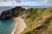 Cliffs and beach next to Durdle Door — Stock Photo