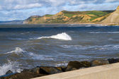 Dorset coastline from West Bay harbour wall — Stock Photo
