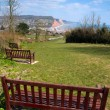 Bench seat in park Sidmouth Devon England — Stock Photo