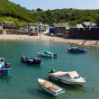 Stock Photo: Boats Polkerris harbour Cornwall England near St Austell and Par on beautiful summer day