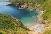 Secluded beach and cove with turquoise sea St Austell Bay Cornwall England — Stock Photo
