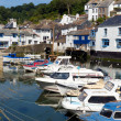 Boats in a row Polperro fishing village harbour Cornwall — Stock Photo