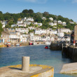 Looe Cornwall England UK with harbour boats yachts and blue sea and sky — Stock Photo