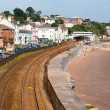 View of Dawlish Devon England with railway track and sea on blue sky summer day — Stock Photo