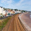Dawlish Devon England with beach railway track and sea on blue sky summer day — Stock Photo