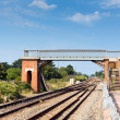 Stock Photo: Bridge over railway track with blue sky