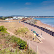 Stock Photo: View of Dawlish Warren beach coast and promenade Devon England on blue sky summer day