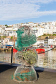 Fishing nets by water at harbourside in English fishing town of Brixham Devon — Stock Photo