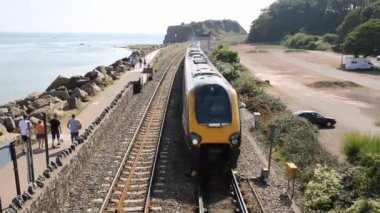 Fast train approaching on coast at Dawlish Warren Devon — Stock Video