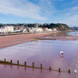 Stock Photo: Holidaymakers on Teignmouth beach Devon England enjoying sunny warm weather