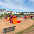 Stock Photo: Childrens play areTeignmouth Devon England enjoying sunny warm weather