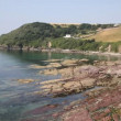 Talland Bay between Looe and Polperro Cornwall England UK on a beautiful blue sky sunny day — Stock Video