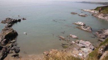 People on Whitsand Bay beach Cornwall coast England UK near to Plymouth — Stock Video