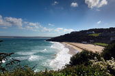 Porthminster beach St Ives Cornwall white waves and blue sea and sky on a beautiful summer day — Stock Photo