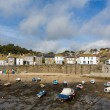 Mousehole harbour Cornwall England UK Cornish fishing village with blue sky and clouds — Stock Photo