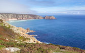 Coast of Cornwall England in autumn with mist and blue sky near the Minack Theatre and Porthcurno — Stock Photo