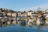 Boats Brixham harbour Devon England on a calm day with blue sky — Stock Photo