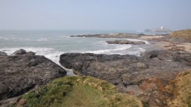 Godrevy lighthouse Cornwall England UK facing the Atlantic Ocean within Area of Outstanding Natural Beauty and features the South West Coast Path — Stock Video