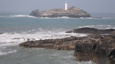 Godrevy lighthouse and island St Ives Bay Cornwall coast England UK facing the Atlantic Ocean within Area of Outstanding Natural Beauty and features the South West Coast Path — Stock Video