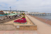 Colourful flowers and holidaymakers Teignmouth pier and beach Devon England UK — Stock Photo