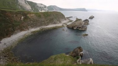 Mupe Bay shingle beach east of Lulworth Cove Dorset England and is part of the Jurassic Coast World Heritage Site — Stock Video