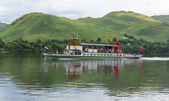 Ullswater Steam ferry with holidaymakers and tourists Lake District Cumbria England UK with green hills — Stock Photo