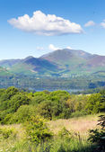 View from Castlerigg Hall Keswick Lake District Cumbria to Derwent Water and Catbells mountains and fells on a summer day with blue sky and sunshine — Stock Photo