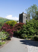 Grasmere village church Cumbria popular tourist destination English Lake District National Park — ストック写真