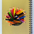 Color pencils and note book — Stock Photo #33614535
