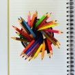 Color pencils and note book — Stock Photo