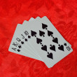 Cards on red felt — Stock Photo