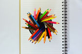 Color pencils and note book — Zdjęcie stockowe