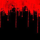 Red color splash on black background — Stock Photo