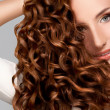 Royalty-Free Stock Photo: Red Hair. Woman with Beautiful Curly Hair