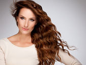 Red Hair. Beautiful Woman with Curly Long Hair — Stock Photo