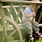 Baby Portrait. Sad boy on the nature background — Stock Photo