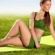 A beautiful sporty woman  doing stretching exercise against natu — Stock Photo