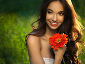 Beautiful Girl With Red Flowers. Beautiful Model Woman Face. — Stock Photo