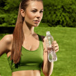 Beautiful Girl drinks Water after Yoga exercise — Stock Photo