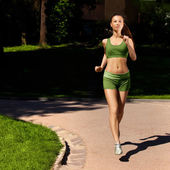 Woman Runner. Fitness Girl Running outdoors — Stock Photo