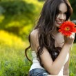 Beautiful Girl With Gerbera Flower Enjoying Nature. — Stock Photo #27093553
