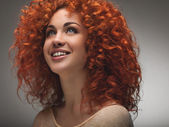 Red Hair. Beautiful Woman with Curly Long Hair. High quality ima — Stock Photo